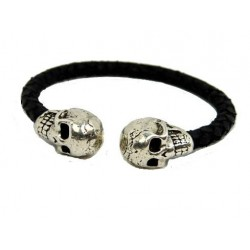Flexible leather cuff bangle with two skulls at the end